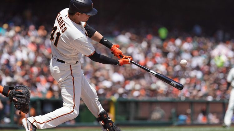Jul 31, 2021; San Francisco, California, USA; San Francisco Giants second baseman Wilmer Flores (41) hits a RBI home run during the third inning against the Houston Astros at Oracle Park. Mandatory Credit: Stan Szeto-USA TODAY Sports