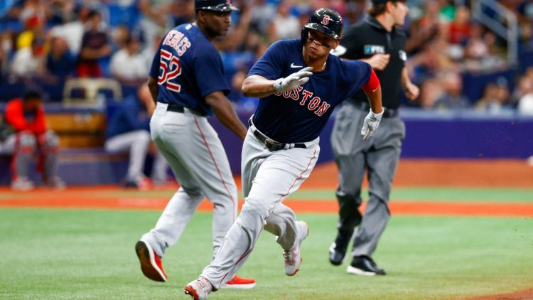Jul 31, 2021; St. Petersburg, Florida, USA; Boston Red Sox third baseman Rafael Devers (11) scores a run in the first inning against the Tampa Bay Rays at Tropicana Field. Mandatory Credit: Nathan Ray Seebeck-USA TODAY Sports
