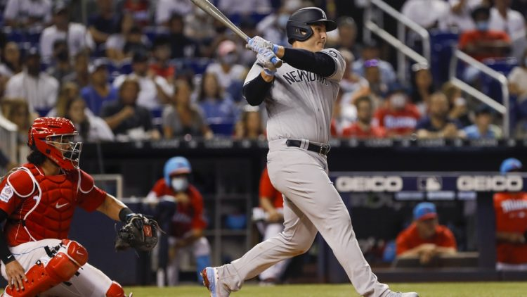 Jul 31, 2021; Miami, Florida, USA; New York Yankees first baseman Anthony Rizzo (48) connects for a base hit during the fifth inning against the Miami Marlins at loanDepot Park. Mandatory Credit: Sam Navarro-USA TODAY Sports