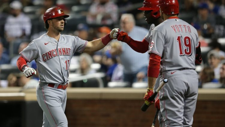 Jul 31, 2021; New York City, New York, USA; Cincinnati Reds shortstop Kyle Farmer (17) celebrates his solo home run against the New York Mets with right fielder Aristides Aquino (44) and first baseman Joey Votto (19) during the fifth inning at Citi Field. Mandatory Credit: Brad Penner-USA TODAY Sports
