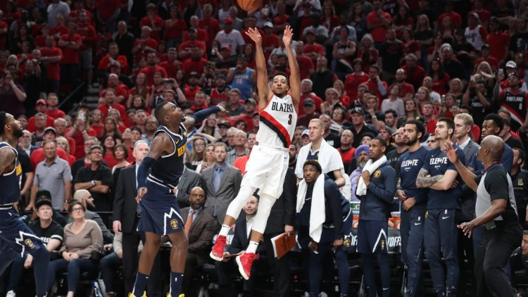 May 5, 2019; Portland, OR, USA; Portland Trail Blazers guard CJ McCollum (3) scores over Denver Nuggets forward Paul Millsap (4) in the second half of game four of the second round of the 2019 NBA Playoffs at Moda Center. Mandatory Credit: Jaime Valdez-USA TODAY Sports