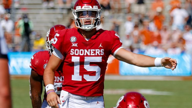 Oct 10, 2020; Dallas, Texas, USA; Oklahoma Sooners quarterback Tanner Mordecai (15) calls the signals against the Texas Longhorns during the third quarter of the Red River Showdown at Cotton Bowl. Mandatory Credit: Andrew Dieb-USA TODAY Sports
