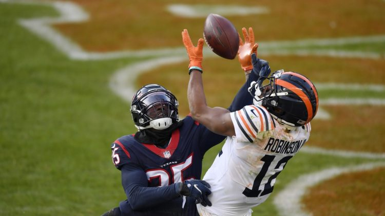 Dec 13, 2020; Chicago, Illinois, USA; Chicago Bears wide receiver Allen Robinson (12) goes up for the football in the third quarter against Houston Texans cornerback Keion Crossen (35) at Soldier Field. Mandatory Credit: Quinn Harris-USA TODAY Sports