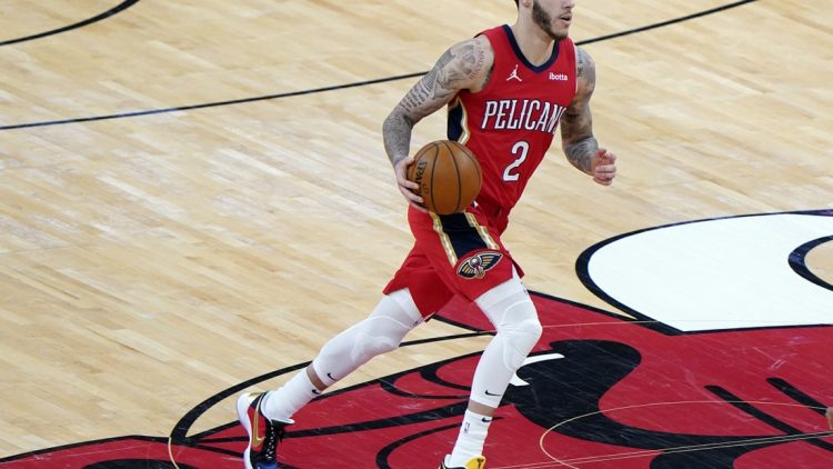 Feb 10, 2021; Chicago, Illinois, USA; New Orleans Pelicans guard Lonzo Ball (2) dribbles the ball against the Chicago Bulls during the third quarter at the United Center. Mandatory Credit: Mike Dinovo-USA TODAY Sports