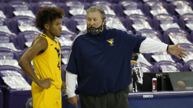 Feb 23, 2021; Fort Worth, Texas, USA; West Virginia Mountaineers head coach Bob Huggins talks to guard Miles McBride (4) during the second half against the TCU Horned Frogs at Ed and Rae Schollmaier Arena. Mandatory Credit: Tim Heitman-USA TODAY Sports