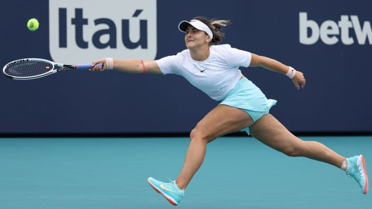 Apr 3, 2021; Miami, Florida, USA; Bianca Andreescu of Canada reaches for a forehand against Ashleigh Barty of Australia (not pictured) in the women's singles final in the Miami Open at Hard Rock Stadium. Mandatory Credit: Geoff Burke-USA TODAY Sports