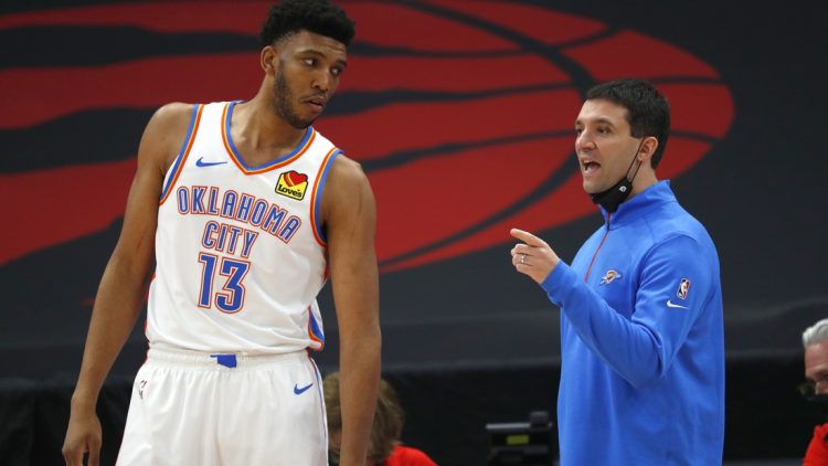 Apr 18, 2021; Tampa, Florida, USA; Oklahoma City Thunder head coach Mark Daigneault talks with center Tony Bradley (13) against the Toronto Raptors during the first half at Amalie Arena. Mandatory Credit: Kim Klement-USA TODAY Sports
