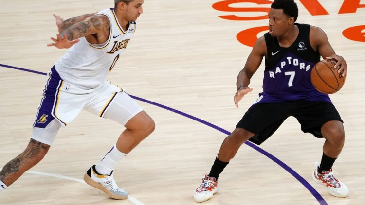 May 2, 2021; Los Angeles, California, USA; Toronto Raptors guard Kyle Lowry (7) controls the ball against Los Angeles Lakers forward Kyle Kuzma (0) during the second half at Staples Center. Mandatory Credit: Gary A. Vasquez-USA TODAY Sports