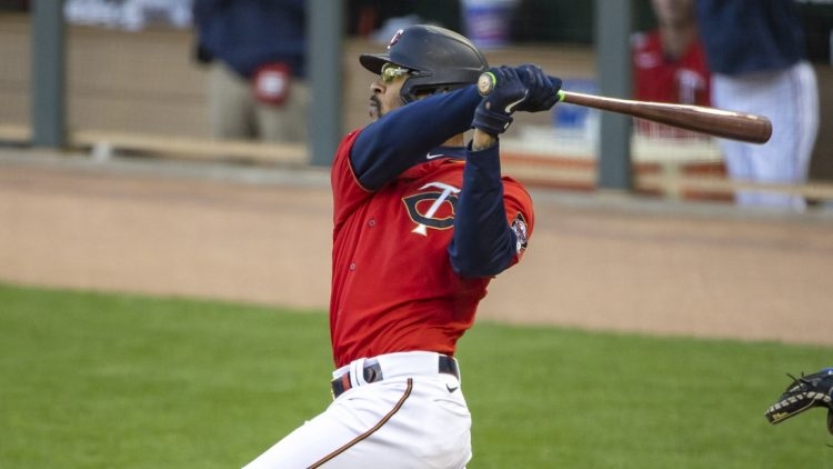 May 4, 2021; Minneapolis, Minnesota, USA; Minnesota Twins center fielder Byron Buxton (25) hits a two-run home run in the first inning against the Texas Rangers at Target Field. Mandatory Credit: Jesse Johnson-USA TODAY Sports