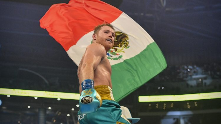 May 8, 2021; Arlington, Texas, USA; Boxer Canelo Alvarez celebrates defeating Billy Joe Saunders during a super middleweight boxing title fight at AT&T Stadium. Mandatory Credit: Jerome Miron-USA TODAY Sports