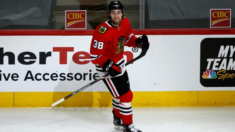 May 9, 2021; Chicago, Illinois, USA; Chicago Blackhawks left wing Brandon Hagel (38) looks up at the replay of his goal during their game against the Dallas Stars at United Center. Mandatory Credit: Eileen T. Meslar-USA TODAY Sports
