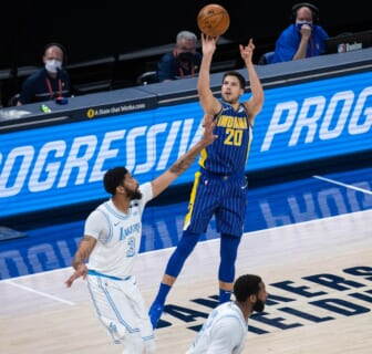 May 15, 2021; Indianapolis, Indiana, USA; Indiana Pacers forward Doug McDermott (20) shoots the ball while Los Angeles Lakers forward Anthony Davis (3) defends in the first quarter at Bankers Life Fieldhouse. Mandatory Credit: Trevor Ruszkowski-USA TODAY Sports