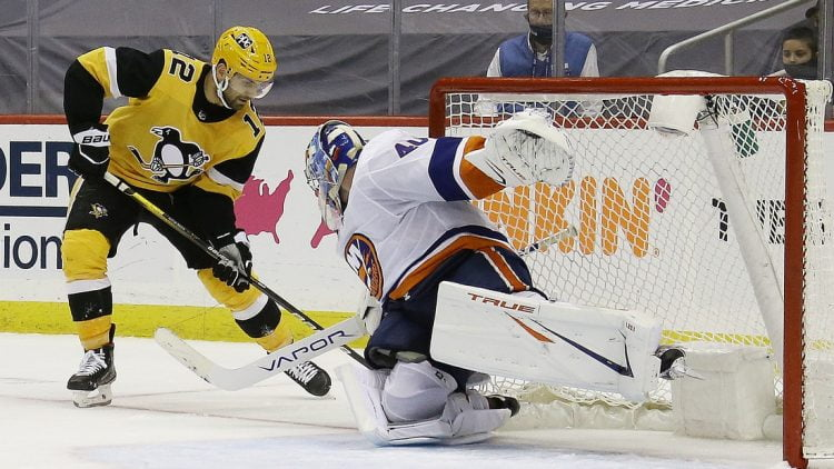 May 18, 2021; Pittsburgh, Pennsylvania, USA;  New York Islanders goaltender Semyon Varlamov (40) defends the net against Pittsburgh Penguins center Zach Aston-Reese (12) during the third period in game two of the first round of the 2021 Stanley Cup Playoffs at PPG Paints Arena. Pittsburgh won 2-1.  Mandatory Credit: Charles LeClaire-USA TODAY Sports