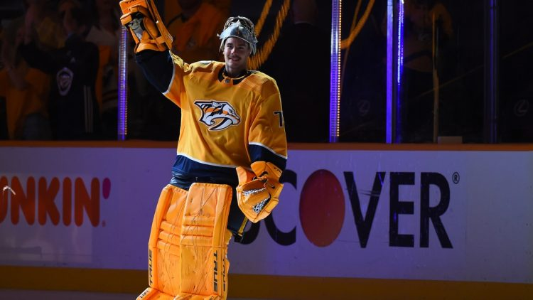 May 21, 2021; Nashville, Tennessee, USA; Nashville Predators goaltender Juuse Saros (74) waives to the crowd after being named the third star of the game after a double overtime win against the Carolina Hurricanes in game three of the first round of the 2021 Stanley Cup Playoffs at Bridgestone Arena. Mandatory Credit: Christopher Hanewinckel-USA TODAY Sports