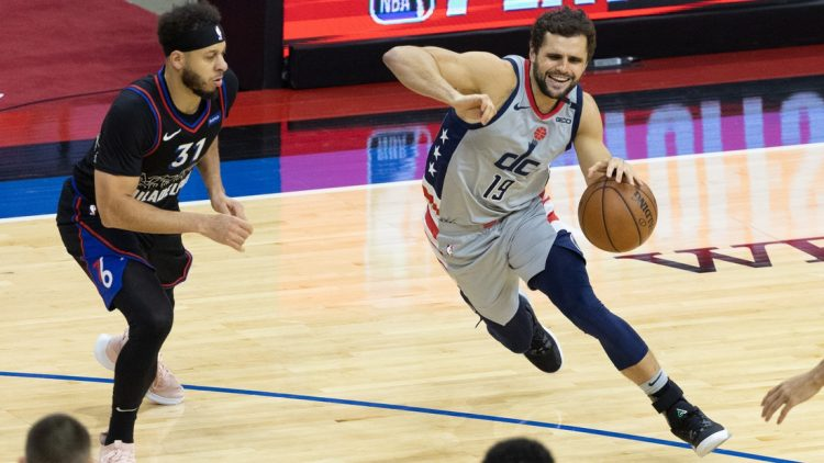 May 26, 2021; Philadelphia, Pennsylvania, USA; Washington Wizards guard Raul Neto (19) drives against Philadelphia 76ers guard Seth Curry (31) during the third quarter of game two in the first round of the 2021 NBA Playoffs at Wells Fargo Center. Mandatory Credit: Bill Streicher-USA TODAY Sports