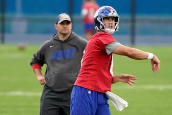 New York Giants quarterback Daniel Jones (8) throws the ball as head coach Joe Judge looks on during OTA practice at the Quest Diagnostics Training Center on Friday, June 4, 2021, in East Rutherford.Giants Ota Practice