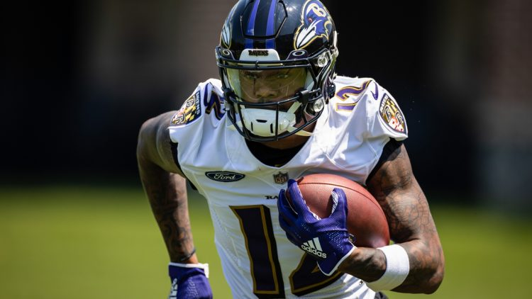 May 26, 2021; Owings Mills, Maryland, USA; Baltimore Ravens wide receiver Rashod Bateman (12) in action during an OTA at Under Armour Performance Center. Mandatory Credit: Scott Taetsch-USA TODAY Sports