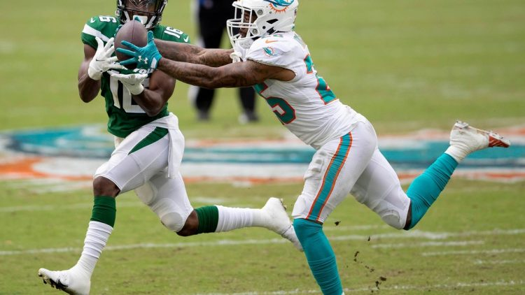 Miami Dolphins cornerback Xavien Howard (25) intercepts a pass intended for New York Jets wide receiver Jeff Smith (16) in the second quarter Sunday at Hard Rock Stadium in Miami Gardens.  Syndication Palm Beach Post
