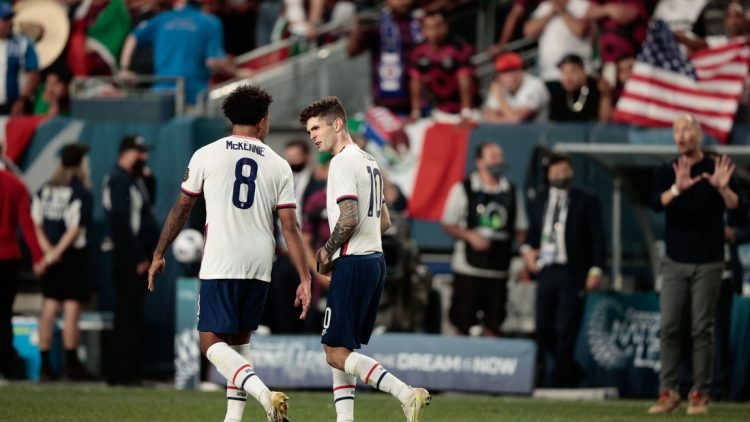 Jun 6, 2021; Denver, Colorado, USA; United States forward Christian Pulisic (10) celebrates with midfielder Weston Mckennie (8) after converting a penalty kick in extra time against Mexico during the 2021 CONCACAF Nations League Finals soccer series final match at Empower Field at Mile High. Mandatory Credit: Isaiah J. Downing-USA TODAY Sports