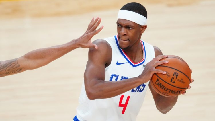 Jun 22, 2021; Phoenix, Arizona, USA; Los Angeles Clippers guard Rajon Rondo (4) against the Phoenix Suns during game two of the Western Conference Finals for the 2021 NBA Playoffs at Phoenix Suns Arena. Mandatory Credit: Mark J. Rebilas-USA TODAY Sports
