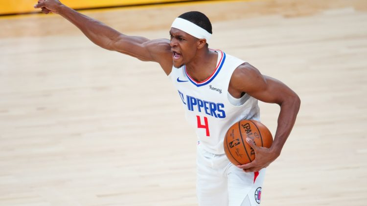 Jun 22, 2021; Phoenix, Arizona, USA; Los Angeles Clippers guard Rajon Rondo (4) reacts against the Phoenix Suns during game two of the Western Conference Finals for the 2021 NBA Playoffs at Phoenix Suns Arena. Mandatory Credit: Mark J. Rebilas-USA TODAY Sports
