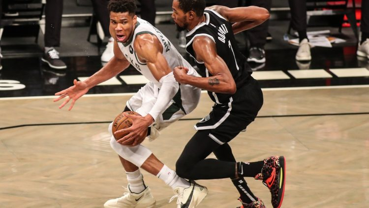 Jun 19, 2021; Brooklyn, New York, USA; Milwaukee Bucks forward Giannis Antetokounmpo (34) and Brooklyn Nets forward Kevin Durant (7) during game seven in the second round of the 2021 NBA Playoffs at Barclays Center. Mandatory Credit: Wendell Cruz-USA TODAY Sports