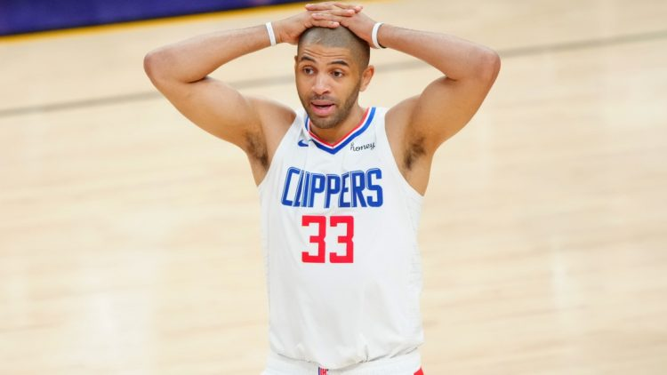 Jun 22, 2021; Phoenix, Arizona, USA; Los Angeles Clippers forward Nicolas Batum (33) reacts against the Phoenix Suns during game two of the Western Conference Finals for the 2021 NBA Playoffs at Phoenix Suns Arena. Mandatory Credit: Mark J. Rebilas-USA TODAY Sports
