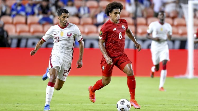 Jul 13, 2021; Houston, Texas, USA; Panama midfielder Adalberto Carrasquilla (8) dribbles the ball as /Qatar midfielder Abdullah Al Ahrak (20) defends during the second half CONCACAF Gold Cup Soccer group stage play at BBVA Stadium. Mandatory Credit: Maria Lysaker-USA TODAY Sports