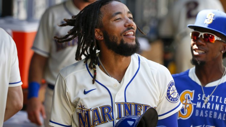 Jul 25, 2021; Seattle, Washington, USA; Seattle Mariners shortstop J.P. Crawford (3) celebrates in the dugout after scoring a run against the Oakland Athletics during the third inning at T-Mobile Park. Mandatory Credit: Joe Nicholson-USA TODAY Sports