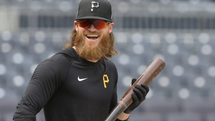 Jul 27, 2021; Pittsburgh, Pennsylvania, USA;  Pittsburgh Pirates left fielder Ben Gamel (18) reacts at the batting cage before a game against the Milwaukee Brewers at PNC Park. Mandatory Credit: Charles LeClaire-USA TODAY Sports