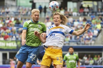 Jul 31, 2021; Seattle, Washington, USA; San Jose Earthquakes midfielder Florian Jungwirth (23) heads the ball during the second half against Seattle Sounders midfielder Kelyn Rowe (22) at CenturyLink Field. The San Jose Earthquakes won the game 1-0. Mandatory Credit: Troy Wayrynen-USA TODAY Sports