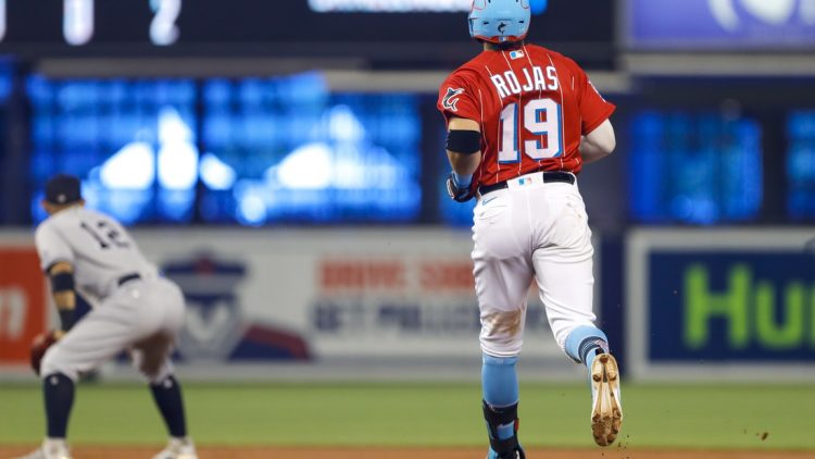 Aug 1, 2021; Miami, Florida, USA; Miami Marlins shortstop Miguel Rojas (19) runs toward second base for a double during the first inning of the game against the New York Yankees at loanDepot Park. Mandatory Credit: Sam Navarro-USA TODAY Sports