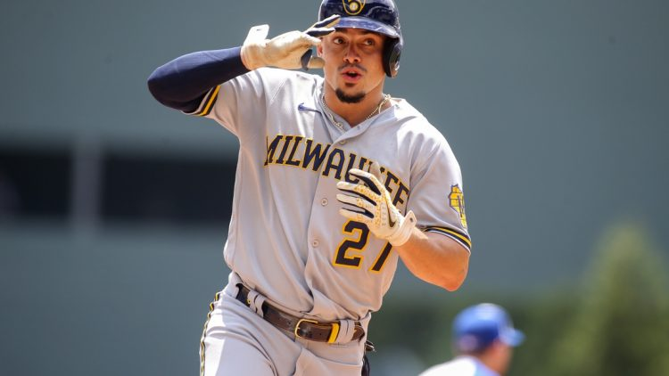 Aug 1, 2021; Atlanta, Georgia, USA; Milwaukee Brewers shortstop Willy Adames (27) celebrates after hitting a home run against the Atlanta Braves in the first inning at Truist Park. Mandatory Credit: Brett Davis-USA TODAY Sports