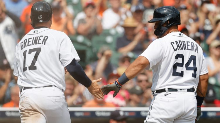 Aug 1, 2021; Detroit, Michigan, USA; Detroit Tigers catcher Grayson Greiner (17) receives congratulations from designated hitter Miguel Cabrera (24) after scoring in the seventh inning against the Baltimore Orioles at Comerica Park. Mandatory Credit: Rick Osentoski-USA TODAY Sports