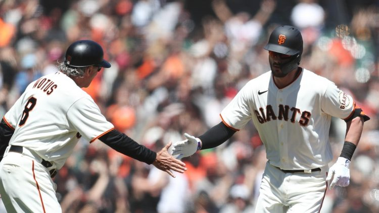 Aug 1, 2021; San Francisco, California, USA; San Francisco Giants third baseman Kris Bryant (23) celebrates with third base coach Ron Wotus (8) after hitting a home run during the third inning against the Houston Astros at Oracle Park. Mandatory Credit: Sergio Estrada-USA TODAY Sports