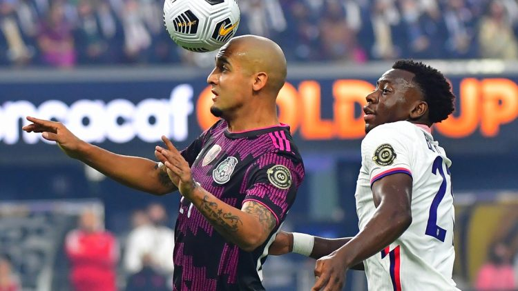 Aug 1, 2021; Las Vegas, Nevada, USA; Mexico defender Luis Rodriguez (21) heads the ball in front of USA defender George Bello (21) during the first half of the CONCACAF Gold Cup final soccer match at Allegiant Stadium. Mandatory Credit: Stephen R. Sylvanie-USA TODAY Sports