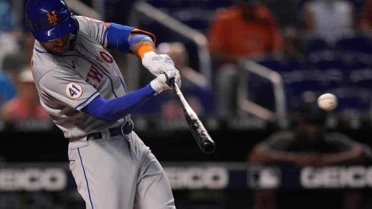 Aug 5, 2021; Miami, Florida, USA; New York Mets center fielder Albert Almora Jr. (4) singles in the 2nd inning against the Miami Marlins at loanDepot park. Mandatory Credit: Jasen Vinlove-USA TODAY Sports