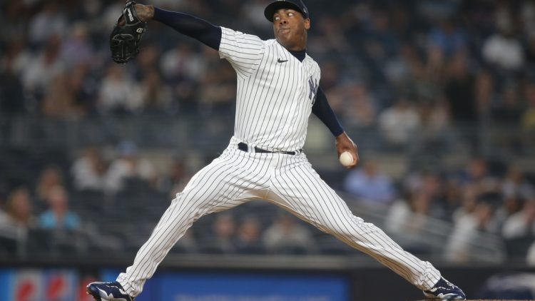 Aug 5, 2021; Bronx, New York, USA; New York Yankees relief pitcher Aroldis Chapman (54) throws a pitch against the Seattle Mariners during the ninth inning at Yankee Stadium. Mandatory Credit: Brad Penner-USA TODAY Sports