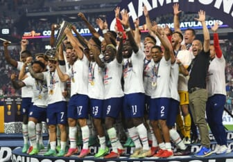 Aug 1, 2021; Las Vegas, Nevada, USA; USA players celebrate after defeating Mexico 1-0 in extra time to win the CONCACAF Gold Cup final soccer match at Allegiant Stadium. Mandatory Credit: Stephen R. Sylvanie-USA TODAY Sports