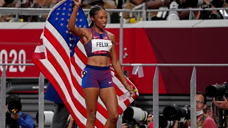 Aug 6, 2021; Tokyo, Japan; Allyson Felix (USA) celebrates winning the bronze medal in the women's 400m final during the Tokyo 2020 Olympic Summer Games at Olympic Stadium. Mandatory Credit: Kirby Lee-USA TODAY Sports
