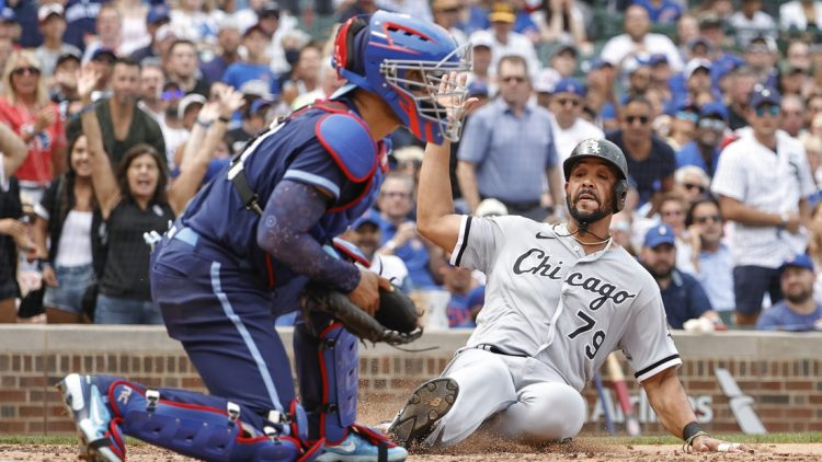 Aug 6, 2021; Chicago, Illinois, USA; Chicago White Sox first baseman Jose Abreu (79) scores against the Chicago Cubs during the fourth inning at Wrigley Field. Mandatory Credit: Kamil Krzaczynski-USA TODAY Sports