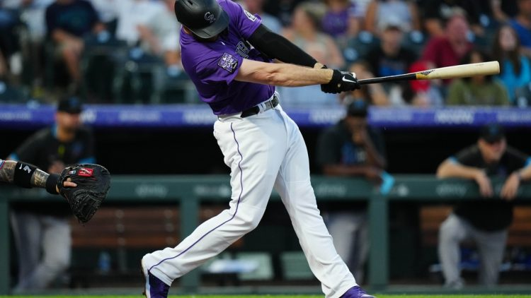 Aug 6, 2021; Denver, Colorado, USA; Colorado Rockies first baseman C.J. Cron (25) hits a three run home run during the fourth inning inning against the against the Miami Marlins at Coors Field. Mandatory Credit: Ron Chenoy-USA TODAY Sports