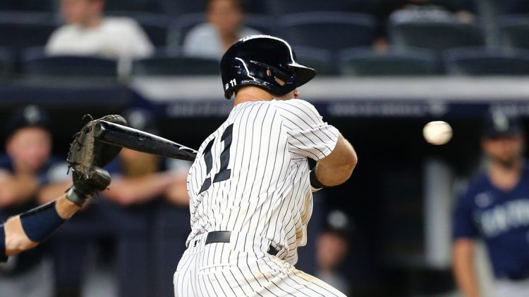 Aug 6, 2021; Bronx, New York, USA; New York Yankees center fielder Brett Gardner (11) hits a game winning walk off RBI single against the Seattle Mariners during the eleventh inning at Yankee Stadium. Mandatory Credit: Andy Marlin-USA TODAY Sports