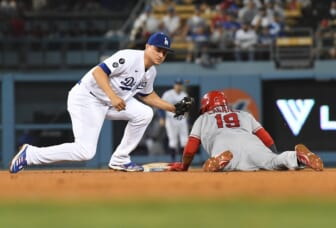 Aug 6, 2021; Los Angeles, California, USA; Los Angeles Angels center fielder Juan Lagares (19) is caught stealing second against Los Angeles Dodgers shortstop Corey Seager (5) during the fifth inning at Dodger Stadium. Mandatory Credit: Richard Mackson-USA TODAY Sports