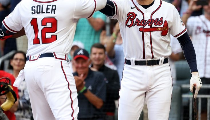 Aug 7, 2021; Atlanta, Georgia, USA; Atlanta Braves outfielder Jorge Soler (12) celebrates his solo home run with first baseman Freddie Freeman (5) during the first inning against the Washington Nationals at Truist Park. Mandatory Credit: Jason Getz-USA TODAY Sports
