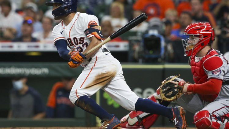 Aug 7, 2021; Houston, Texas, USA; Houston Astros second baseman Jose Altuve (27) hits a single against the Minnesota Twins in the fifth inning at Minute Maid Park. Mandatory Credit: Thomas Shea-USA TODAY Sports