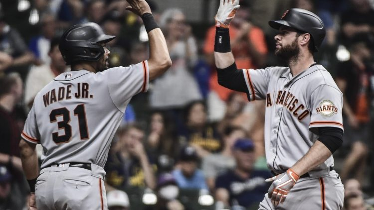 Aug 7, 2021; Milwaukee, Wisconsin, USA; San Francisco Giants first baseman Brandon Belt (9) is greeted by center fielder LaMonte Wade Jr (31) after hitting a two-run home run in the eleventh inning against the Milwaukee Brewers at American Family Field. Mandatory Credit: Benny Sieu-USA TODAY Sports