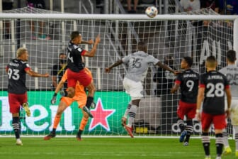 Aug 8, 2021; Washington, DC, Washington, DC, USA;  D.C. United midfielder Andy Najar (14) heads the ball into the net for a goal against the CF Montr al during the first half at Audi Field. Mandatory Credit: Rafael Suanes-USA TODAY Sports