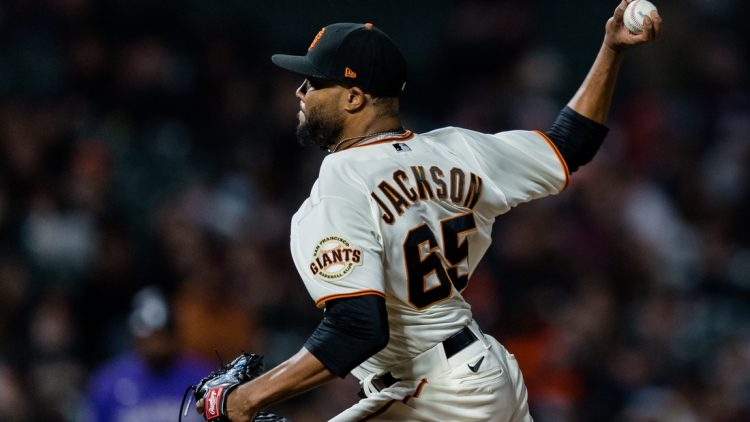 Aug 12, 2021; San Francisco, California, USA; San Francisco Giants pitcher Jay Jackson (65) throws against the Colorado Rockies in the seventh inning at Oracle Park. Mandatory Credit: John Hefti-USA TODAY Sports