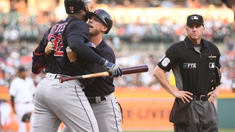 Aug 13, 2021; Detroit, Michigan, USA; Cleveland Indians third base coach Kyle Hudson (97) holds back right fielder Franmil Reyes (32) after being ejected from the game by umpire Ryan Blakney (36) during the third inning against the Detroit Tigers at Comerica Park. Mandatory Credit: Tim Fuller-USA TODAY Sports